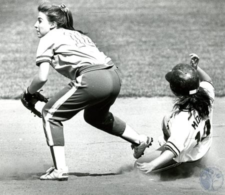 Image: di75986 - Unidentified softball player sliding in behind the opposing team's player