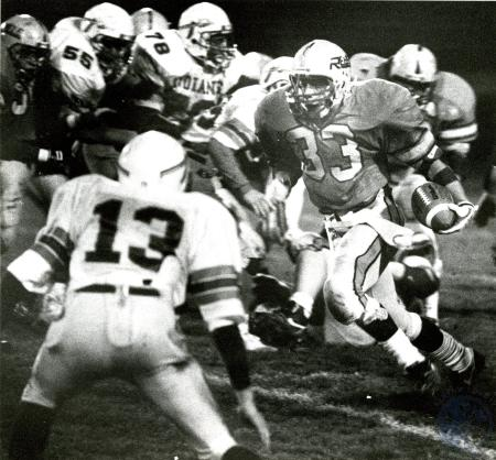 Image: di76052 - Unidentified Boone County High School running ball. Unidentified opposing team.