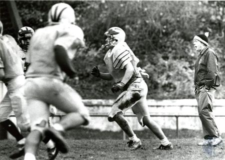 Image: di76056 - Unidentified Bellevue High School coach (could be Charlie Coleman) and players at football practice