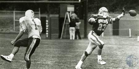 Image: di76161 - Unidentified Newport Central Catholic (breds jersey) High School defender knocking down a pass intended....