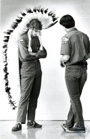 Image: di76306 - Unidentified boy scouts, one wearing Native American head dress.