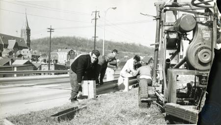 Image: di77822 - State Highway Department Crew, installing 120 ft of new guardrail on southbound side of median strip.....