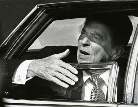 Image: di78365 - Ronald Reagan rools up window of limo as KY Post reporter quizzes him about coal connection