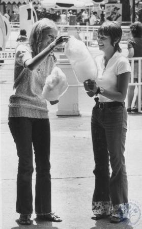 Image: di80818 - Cheryl Duffner and Debbie Haynes of Ludlow, KY at Coney Island, eating cotton candy.