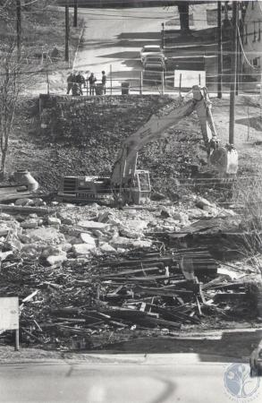 Image: di81053 - Old Wagon Bridge concrete supports are removed from Railroad tracks - shot from Central St., looking....