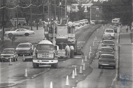 Image: di81064 - John R. Jurgensen Construction Co., Cincinnati, using large machine to take surface off Dixie Highway....