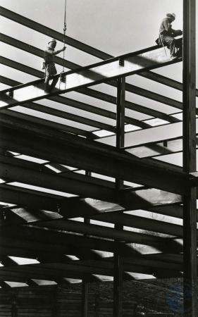 Image: di82848 - Danny Showberg and another ironworker attaching beam into place at the Southgate Medical Building on....