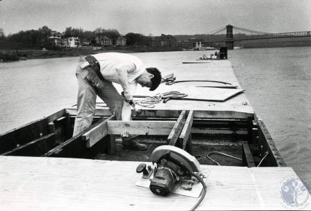 Image: di83223 - Unidentified carpenter working on a dock in Ohio River