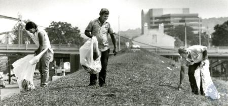 Image: di83999 - James Thurman, Joe Runyon and Willard Terry collect trash left by Riverfest goers along the flood wall....