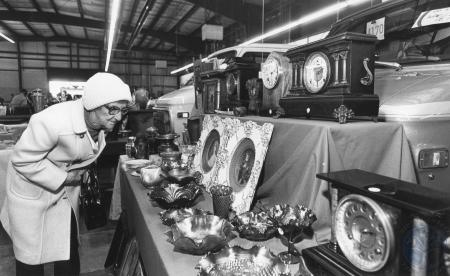 Image: di84140 - Cynthia Lee (76), Erlanger, looking at the antiques on display at Suburban Chevrolet, Florence.