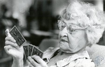 Image: di85431 - Carrie Mueller plays cards