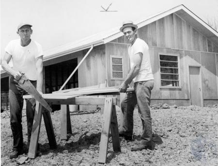Image: di85566 - L-R: Heinz Wahrenburg and Randall Robinson, carpenters at Big Bone Lick State Park, work on office building....