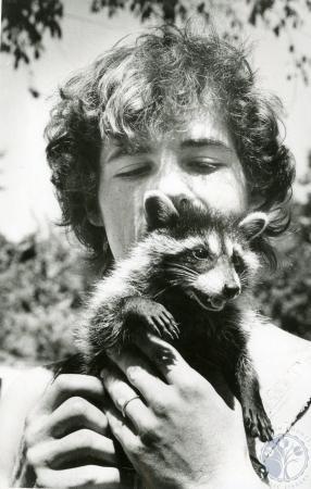 Image: di86268 - Pete Montoure (20) with pet Raccoon named Ziggy.