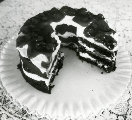 Image: di88358 - Dessert; a layered bundt cake with  slices missing