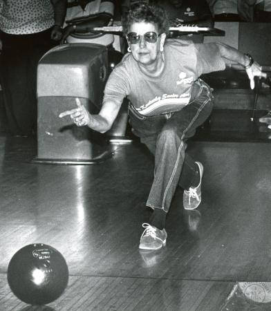 Image: di89094 - Rita Wahl (66), Crestview Hills, follows up her shot at the bowling pins during the Senior Games Bowling....