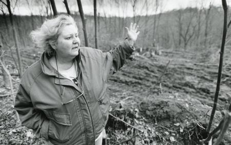 Image: di89394 - Nancy Montague Grall says the area behind her is the location of her family's cemetery in Devou Park.....