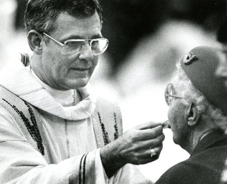 Image: di89968 - Bishop James Kendrick Williams serves a communion wafer.