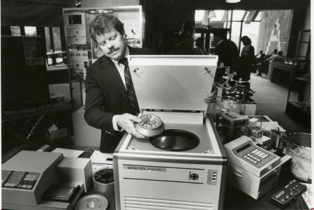 Image: di90332 - Chad Way demontrates the loading of a refrigreated micro centrifuge a the KY Academy of Science Metting....