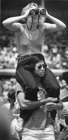 Image: di91391 - In the infield at the Kentucky Derby. Unidentified woman sitting on man's shoulders.