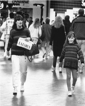 Image: di91650 - Mary Sweeney and daughter Kathleen Sweeney, 8, of Crescent Springs were among the many last minute Christmas....