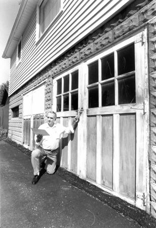 Image: di92904 - Fred Lincke of Ludlow studies a drawing showing how to fix the blacktopped-in garage doors.  The city....