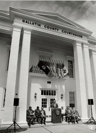 Image: di95843 - Kentucky, American, and Canadian flags fly at the front of the courthouse for the announcement of the....