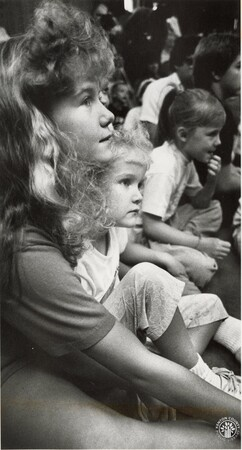 Image: di95897 - Heather Nienaber, 10 and sister Michele Nienaber, 5, listen Ft. Wright police speak about what to do....