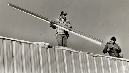 Image: di95984 - Dave Becker, Ft. Wright, carries a piece of trim to finish edge of new Southern Campbell Fire Station.....