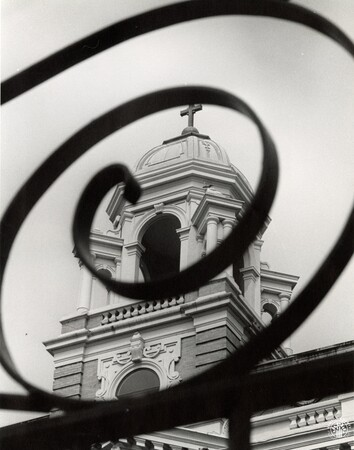 Image: di96652 - Looking through an ornate wrought iron fence that surrounds the beautiful dome on top. The building is....