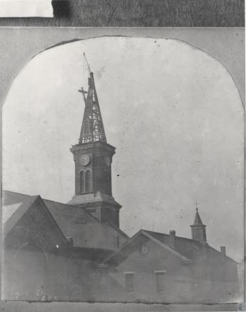 Image: kce001005photo - Cross being lifted down from old (c. 1867, designed by Louis Picket) spire of St. Aloysius Church; looking....