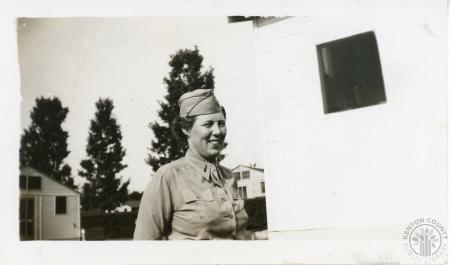 Image: kcpl046060072 - Woman in uniform. Stamped
