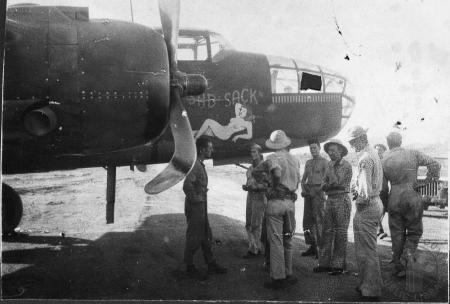 Image: kcpl046062016 - Men standing in front of airplane with