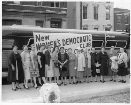 Image: kcpl046074006 - New Women's Democratic Club standing beside a bus.
