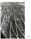di02273 - boys walking on rails in railroad yard
