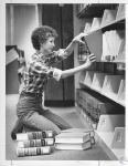 di12700 - Carol Bredemeyer shelving books in Chase ...