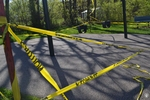 di128367 - Caution tape surrounds play equipment at ...