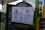 di128415 - Coronavirus symptoms warning sign at FastPark, ...