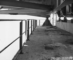 di128675 - Looking upstream at railing pier 8, I-471 ...
