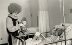 di140362 - Clown (Larry Ruby) with unidentified patient ...