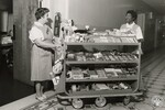 di140364 - Unidentified workers with candy cart at St. ...
