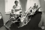 di140365 - Unidentified children in sleigh with gifts ...