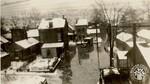 di141022 - Truck driving down a flooded street.
