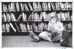 di16248 - Nikki Carter reading in Children's Department