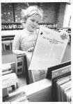 di16282 - Kathy Brewer looking through records