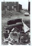 di36372 - Wrecked car in Ida Spence Homes