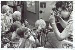 di37743 - Teacher Charotte Schneider playing a sing ...