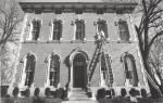 di42023 - Charles Marquardt applies caulking to windows ...