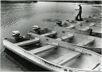 di44120 - unidentified youth working at boat dock