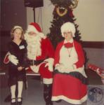 di45117 - Kimberly Clark with Santa and Mrs. Claus
