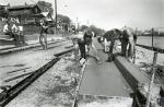 di47388 - workers installing curbs as part of reconstructing ...